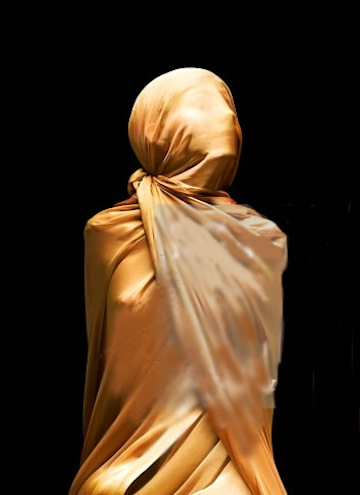 149824433-girl-bound-covered-in-silk-gettyimages